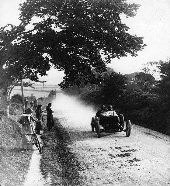 Road-side spectators stop to watch a 'Straker Squire'...