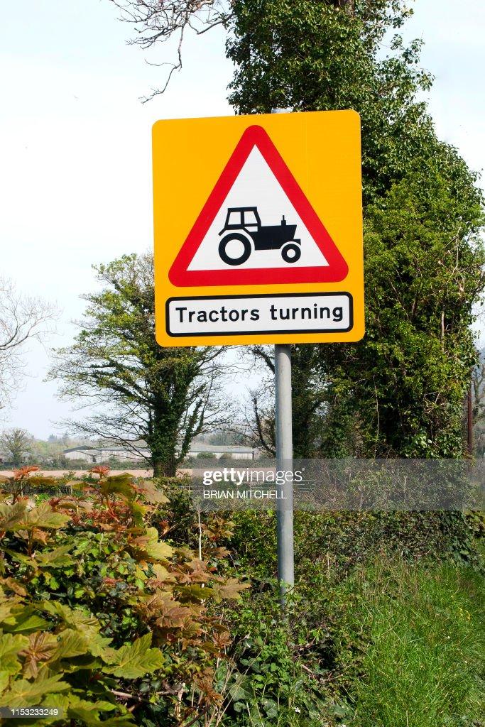 Roadside traffic warning sighn, 'Beware of Agricultural Tractors' : Stock Photo