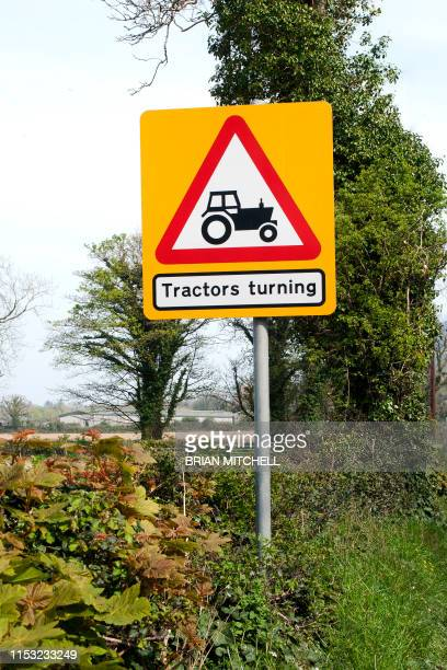 roadside traffic warning sighn, 'beware of agricultural tractors' - image stock pictures, royalty-free photos & images