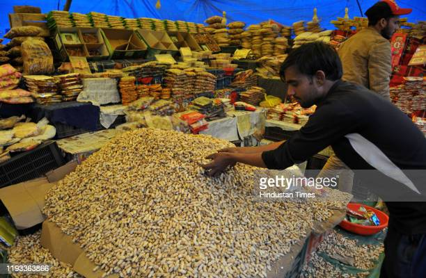 Roadside vendor displays customary eatables like peanuts, popcorns and other snacks ahead of Lohri festival, which will celebrated on 13th January...