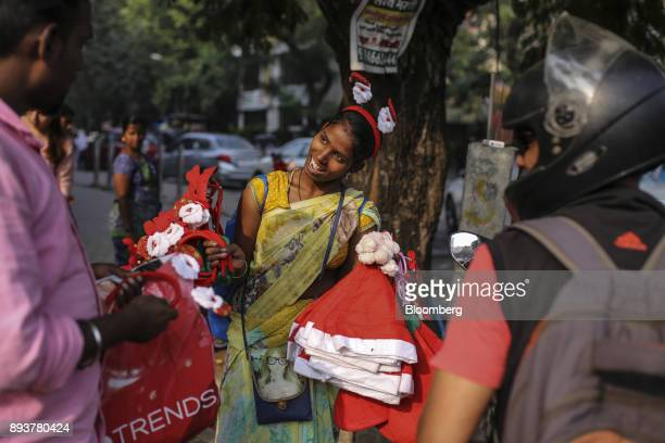 A roadside vendor sells festive Christmas hats and hairbands in Mumbai India on Friday Dec 15 2017 India's inflation surged past the central bank's...