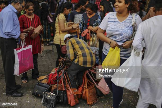 A roadside vendor sells handbags in Mumbai India on Friday Dec 15 2017 India's inflation surged past the central bank's target bolstering a view that...