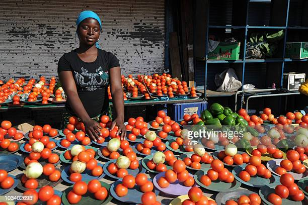 A roadside vendor sells tomatoes onions and green peppers at the Alexandra township near Johannesburg on June 22 2010 moments before South Africa...