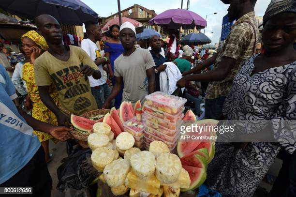 Roadside vendors display assorted fruits for sale to Muslims shopping to break fast to celebrate Eid el Fitr in Lagos on June 24 2017 Muslims across...