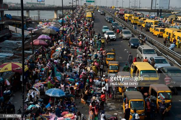 Roadside vendors take over Idumota road to sell their wares ahead of Chritsmas festival in Lagos, on December 16, 2019. - As Christmas festival and...