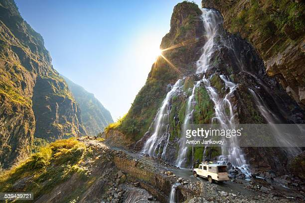 roadside waterfall - mountain road stock pictures, royalty-free photos & images