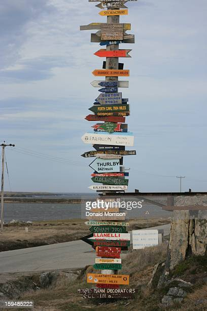 CONTENT] A roadsign that shows where places are around the world Located about 1 mile east of Stanley heading for Stanley airport