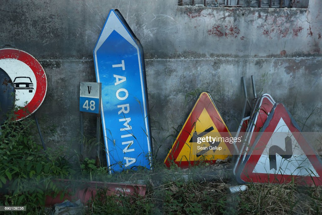 Roadsigns, including one for pointing in the direction of the village of Taormina, lie next to a building during the G7 Taormina summit on the island of Sicily on May 27, 2017 in Giardini Naxos, Italy. The G7 Taormina summit ended with no signs of unity between the U.S. and the other member states. German Chancellor Angela Merkel, in a statement days later, said the experience of the summit had shown her that Europe can no longer rely on both the United Staes and the United Kingdom as the partners it has known for decades.