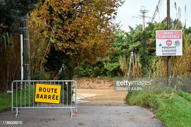 Roadsigns indicating a closed route due to flooding stand on a road at Pertuis southern France on December 2 following fresh torrential rains over...