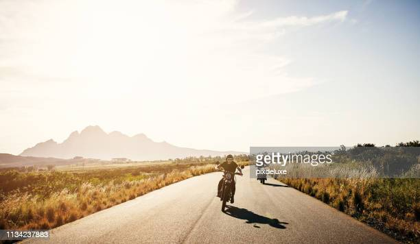 roadtripping the best way they know how - motorcycle stock pictures, royalty-free photos & images