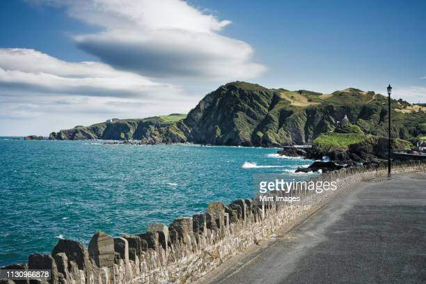 roadway along coast - ilfracombe stock pictures, royalty-free photos & images