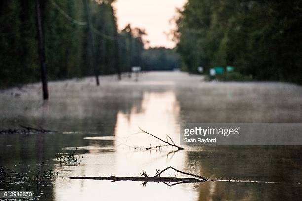 A roadway is flooded by remnants of Hurricane Matthew on October 11 2016 near Dillon South Carolina The region is still assessing the full magnitude...