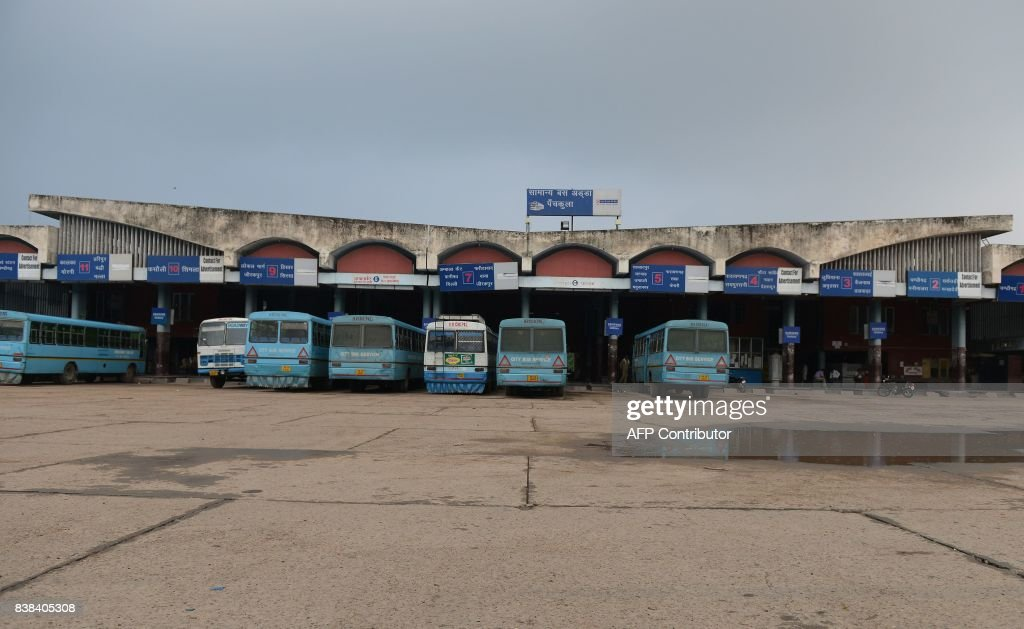 Roadways buses sit parked at the deserted bus terminal in Panchkula near Chandigarh on August 24 2017 Tens of thousands of supporters of a...