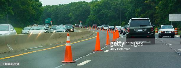 roadwork on the highway - road construction stock photos and pictures