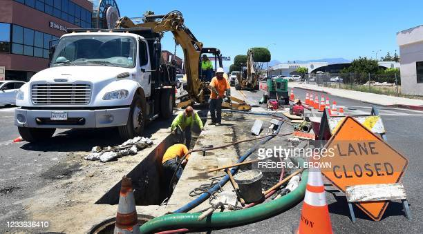 Roadworks crew work in Monterey Park, California on June 24, 2021. - US President Joe Biden on Thursday announced that a deal has been reached with a...