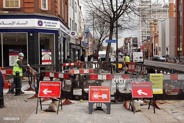Roadworks on the A11 road in east London which was due to form part of the Olympic marathon route in 2012 however the race will now be staged...