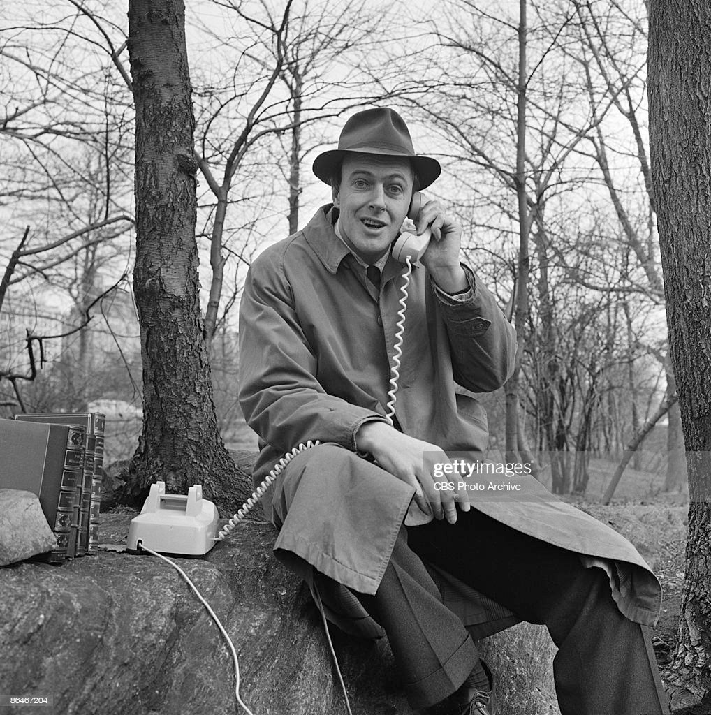 Roald Dahl answers a telephone while filming an episode of the science fiction show 'Way Out' in Central Park, New York, March 25, 1961.