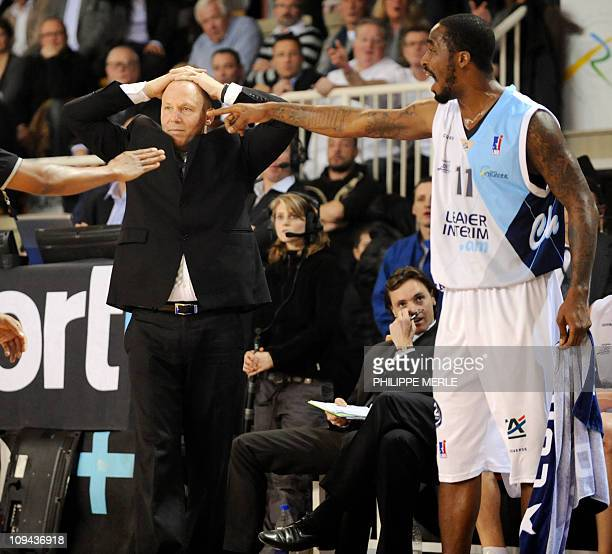 Roanne basket team French coach JeanDenis Choulet reacts as Roanne US guard Ricky Davis gestures during the French ProA basketball match Roanne vs...