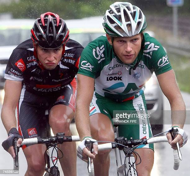 French Remi Pauriol and compatriot Nicolas Portal ride in the pack during the Dauphine Libere Criterium first stage 11 June 2007 between Grenoble and...