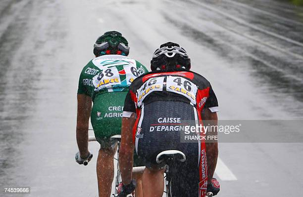 French Remi Pauriol and compatriot Nicolas Portal rides in the pack during the Dauphine Libere Criterium first stage 11 June 2007 between Grenoble...