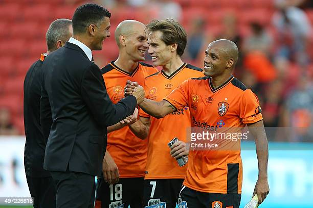 Roar coach John Aloisi and HENRIQUE celebrates after winning during the round six ALeague match between Brisbane Roar and Perth Glory at Suncorp...