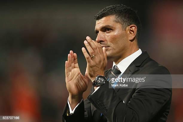 Roar coach John Aloisi look dejected after defeat as he applauds the crowd during the ALeague Semi Final match between the Western Sydney Wanderers...