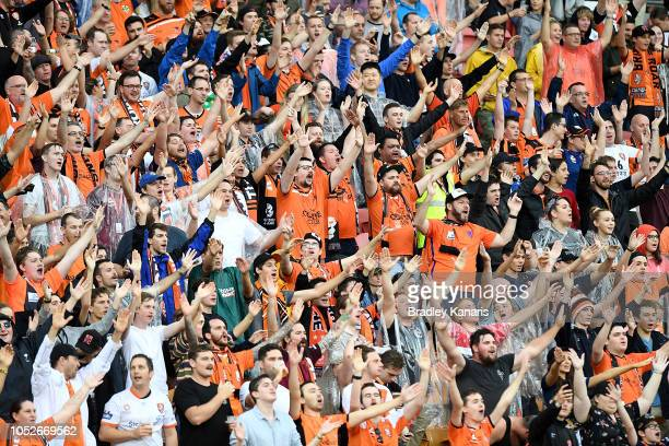 Roar fans show their support during the round one ALeague match between the Brisbane Roar and the Central Coast Mariners at Suncorp Stadium on...