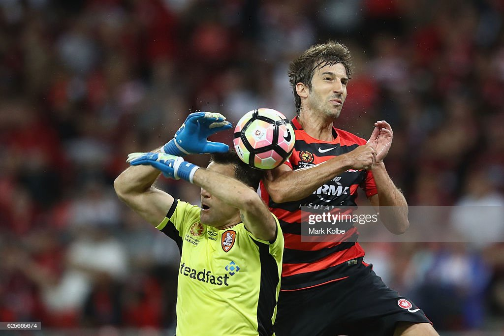 Roar goal keeper Michael Theo and Artiz Borda of the Wanderers compete for the ball in the air during the round eight A-League match between the Western Sydney Wanderers and the Brisbane Roar at Spotless Stadium on November 25, 2016 in Sydney, Australia.