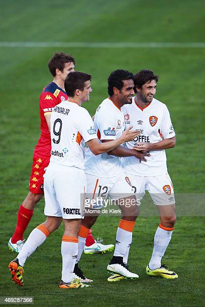 Roar players celebrate an owngoal by Adelaide during the round 25 ALeague match between Adelaide United and the Brisbane Roar at Coopers Stadium on...