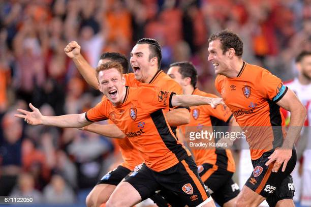 Roar players celebrate victory after a shoot out in extra time during the ALeague Elimination Final match between the Brisbane Roar and the Western...
