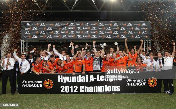Roar players celebrate victory after the 2012 ALeague Grand Final match between the Brisbane Roar and the Perth Glory at Suncorp Stadium on April 22...