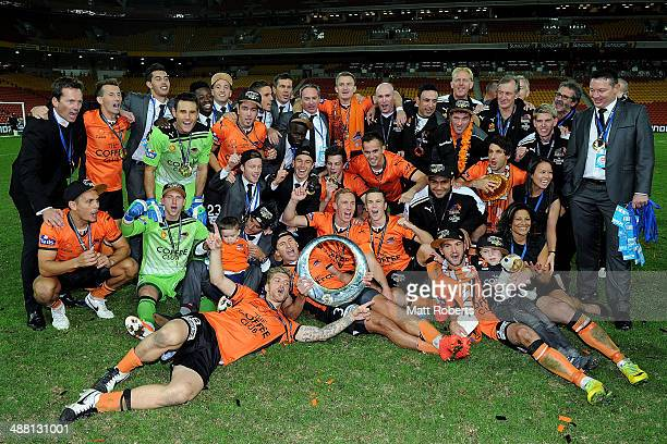 Roar players celebrate victory after the 2014 A-League Grand Final match between the Brisbane Roar and the Western Sydney Wanderers at Suncorp...