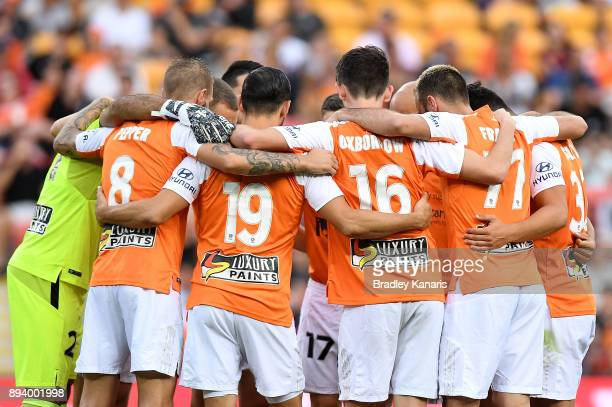 Roar players embrace before the round 11 ALeague match between the Brisbane Roar and the Melbourne Victory at Suncorp Stadium on December 17 2017 in...