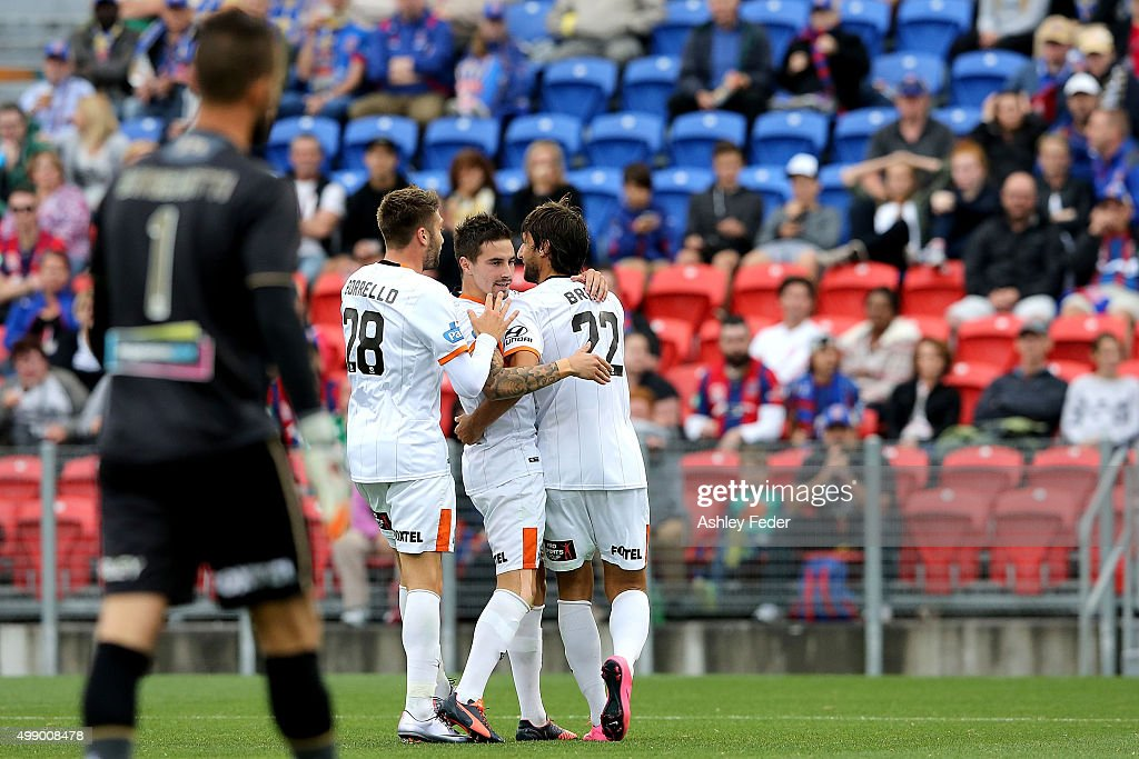 Roar team mates celebrate a goal from Jamie Maclaren during the round eight A-League match between the Newcastle Jets and Brisbane Roar at Hunter Stadium on November 28, 2015 in Newcastle, Australia.
