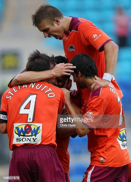 Roar team members celebrate after James Meyer scored a goal in the second half during the round 25 A-League match between the Brisbane Roar and the...