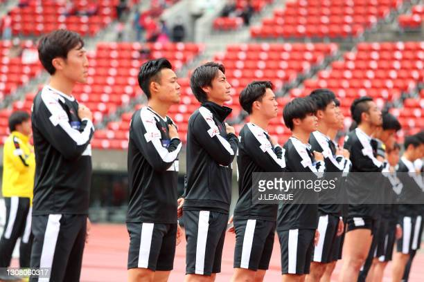 Roasso Kumamoto players observe a minute of silence for the victims of 2016 Kumamoto Earthquakes prior to the J.League Meiji Yasuda J3 match between...
