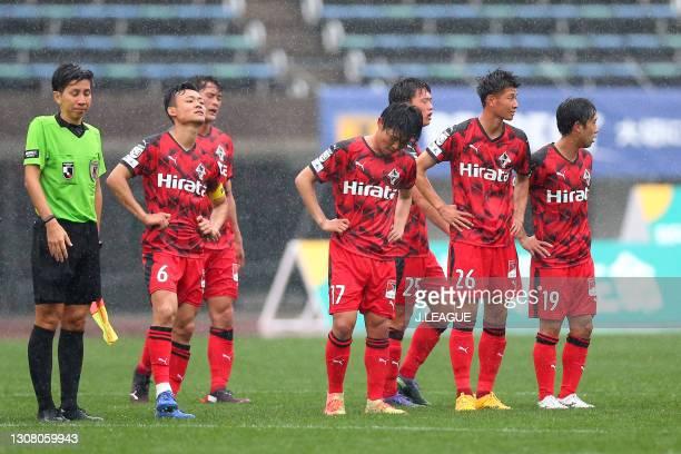 Roasso Kumamoto players show dejection after the 2-2 draw in the J.League Meiji Yasuda J3 match between Roasso Kumamoto and Kagoshima United at Egao...