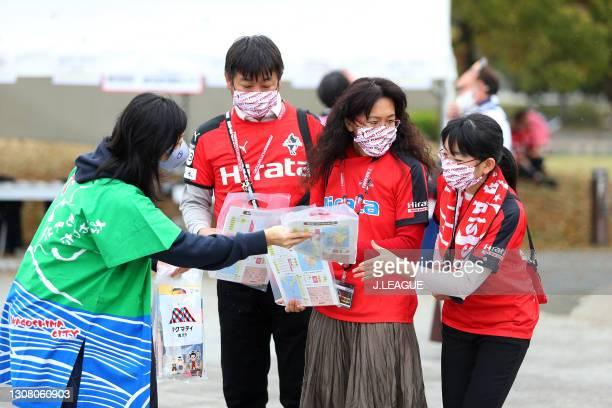 Roasso Kumamoto supporters arrive at the stadium prior to the J.League Meiji Yasuda J3 match between Roasso Kumamoto and Kagoshima United at Egao...