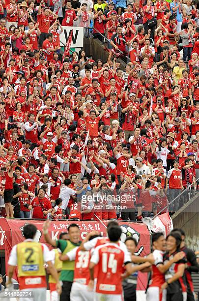 Roasso Kumamoto supporters celebrate their team's first goal during the J.League second division match between Roasso Kumamoto and Cerezo Osaka at...