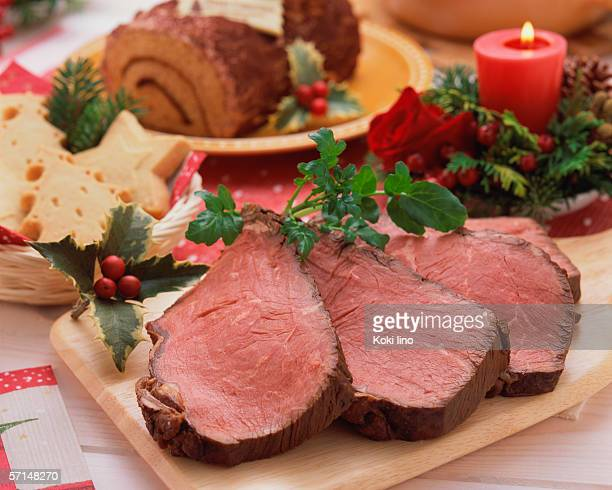 roast beef and christmas cake - yule log stock pictures, royalty-free photos & images