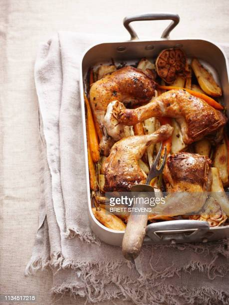 roast chicken and vegetables in pan - ready to eat stock pictures, royalty-free photos & images