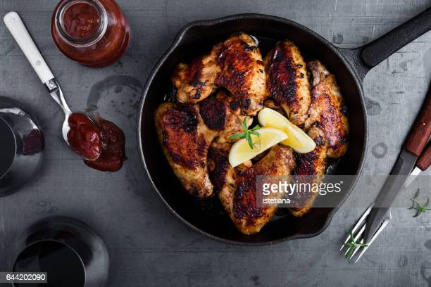Roast chicken wings in cast iron pan