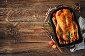 Roast Christmas duck with thyme and apples