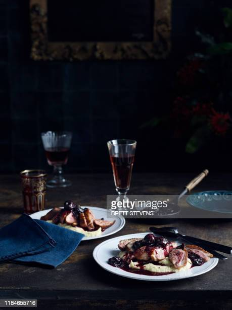 roast duck with celeriac puree cherry and pinot sauce - bastille day stock pictures, royalty-free photos & images