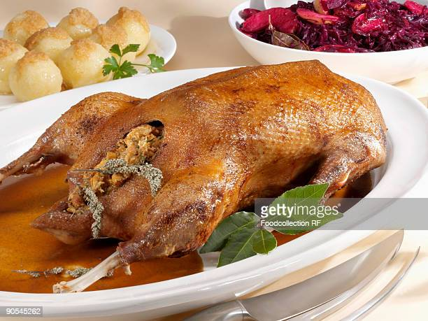 Roast Goose with Stuffed Potatoes and Red Cabbage as Side Dishes