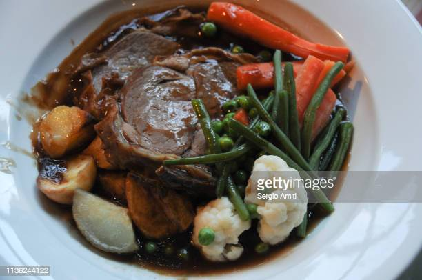 Roast pork and vegetables with gravy