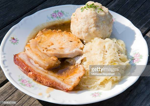 Roast pork with bread dumplings and sauerkraut