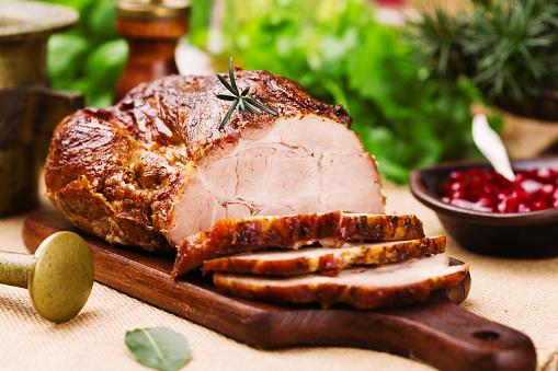 Roast pork with cranberry dip, basil, coriander and rosemary. 547520688