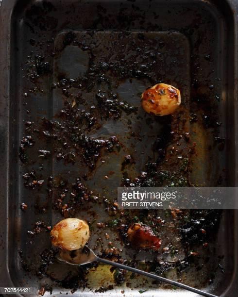 Roast potatoes in baking tray