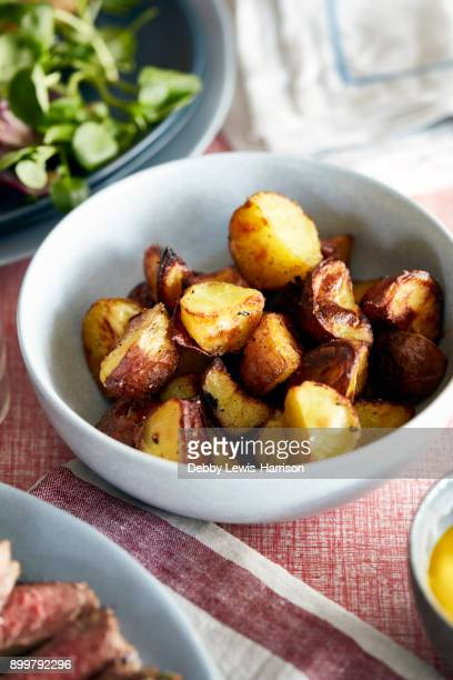 Roast potatoes in bowl, close-up